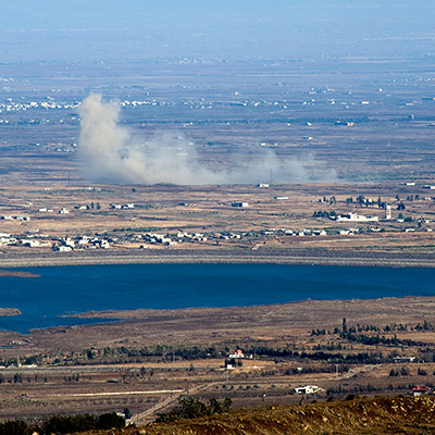 Artillery shelling, distant explosions