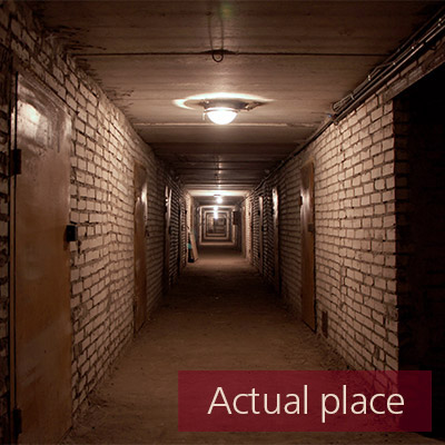 Footsteps on concrete, one person running in tunnel