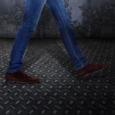 Footsteps on metal, male shoes, slow walk