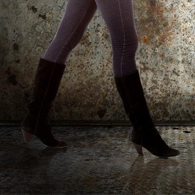 Footsteps on metal, female shoes, slow walk