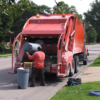 Garbage  truck working, garbage container