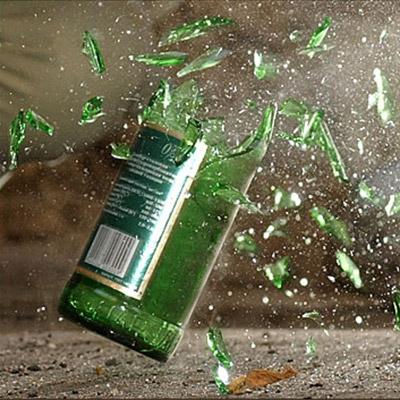 Glass bottle break against the wall - 01
