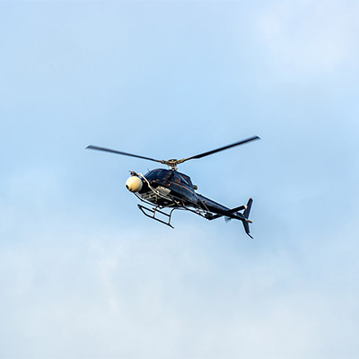 Helicopter flying far