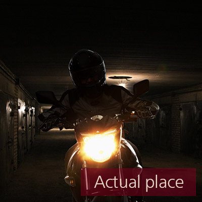 Motorcycles passing by in parking garages