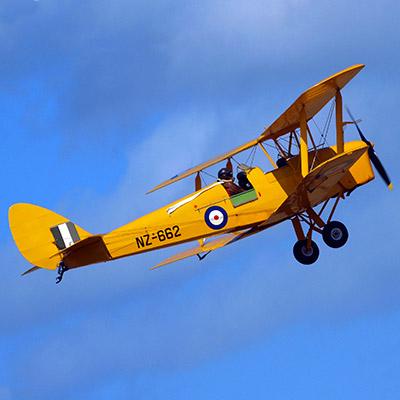 Propeller plane flying, aerobatics, vintage recording