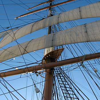 Sails flapping, mast creaking