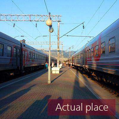 Train station, platform, announcement (no voice)