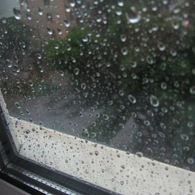 Rain on aluminium window sill (close distance)